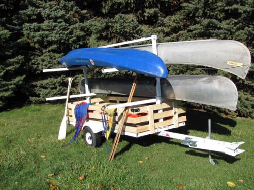 #UCT4 - 4 PLACER CANOE TRAILER WITH SWING A WAY TONGUE EXTENDER