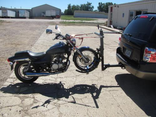 TOW YOUR MOTORCYCLE FROM YOUR RECEIVER HITCH.